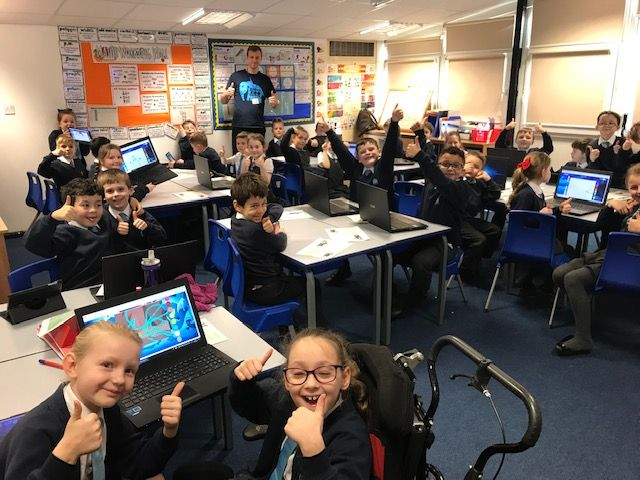 Classroom giving thumbs up.