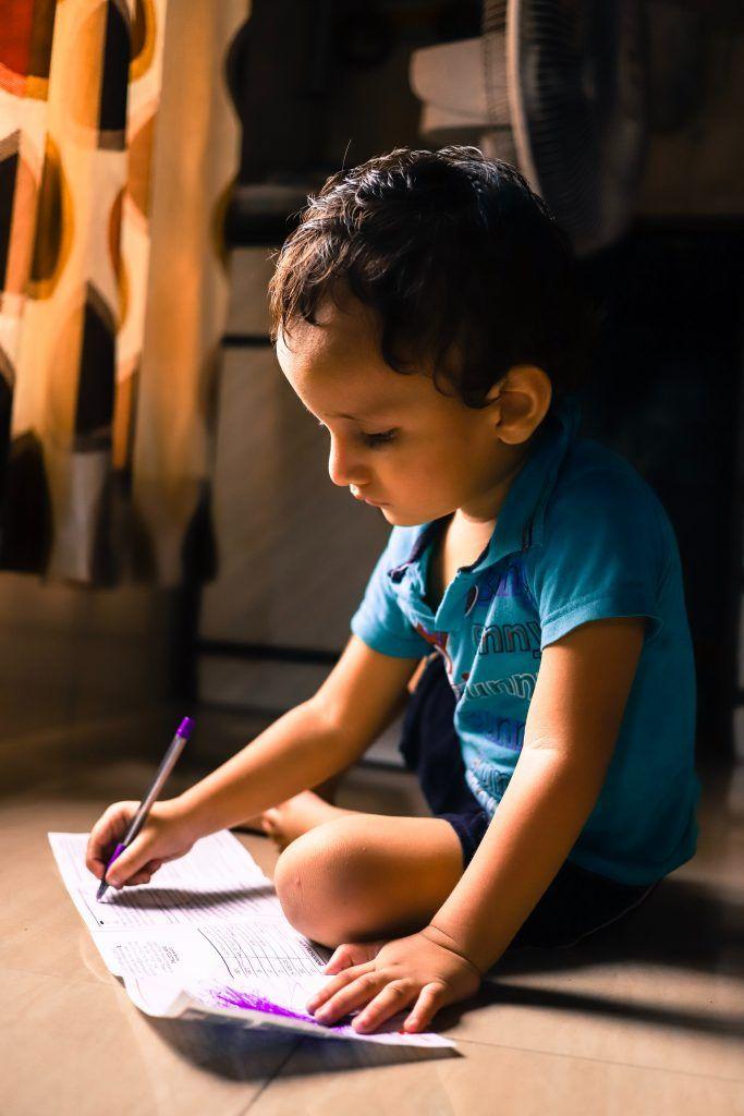 Child writing.
